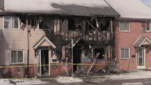Fire damage to a row of townhouses on Kimberley Avenue in London, Ont. is seen on Wednesday, Jan. 22, 2020. (Gerry Dewan / CTV London)
