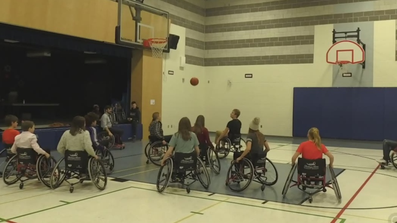 Students learning to play wheelchair basketball
