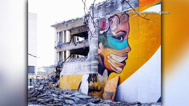 A mural dedicated to MMIWG, entitled 'Nibaa' by Mike Valcourt was torn down with the demolition of the old Winnipeg police headquarters building. (Source: Instagram/Cranial_Tyrant)