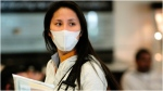 A woman wearing a surgical mask enters Termial D of Dallas/Fort Worth Airport after arriving on American Airlines Flight 60 from Tokyo Thursday, March 17, 2011, in Dallas. Many of the passengers on the flight were in Japan when the earthquake and tsunami hit the northern part of the country. (AP Photo/The Fort Worth Star-Telegram, Max Faulkner) MAGS OUT; NO SALES