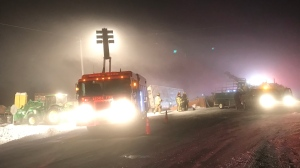 Crews work to get two semis out of the ditch after a crash Wednesday afternoon. Jan. 22, 2020. (CTV News Edmonton)