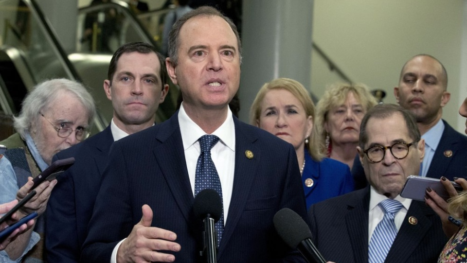 House Intelligence Committee Chairman Adam Schiff, D-Calif., accompanied by the impeachment managers speaks to reporters, on Capitol Hill in Washington, Wednesday, Jan. 22, 2020. (AP Photo/Jose Luis Magana)