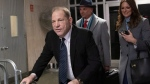 Harvey Weinstein, left, leaves the courtroom with his attorneys Arthur Aidala, and Donna Rotunno at the end of the first day of his trial on rape and sexual assault charges, Wednesday, Jan. 22, 2020, in New York. (AP Photo/Mary Altaffer)