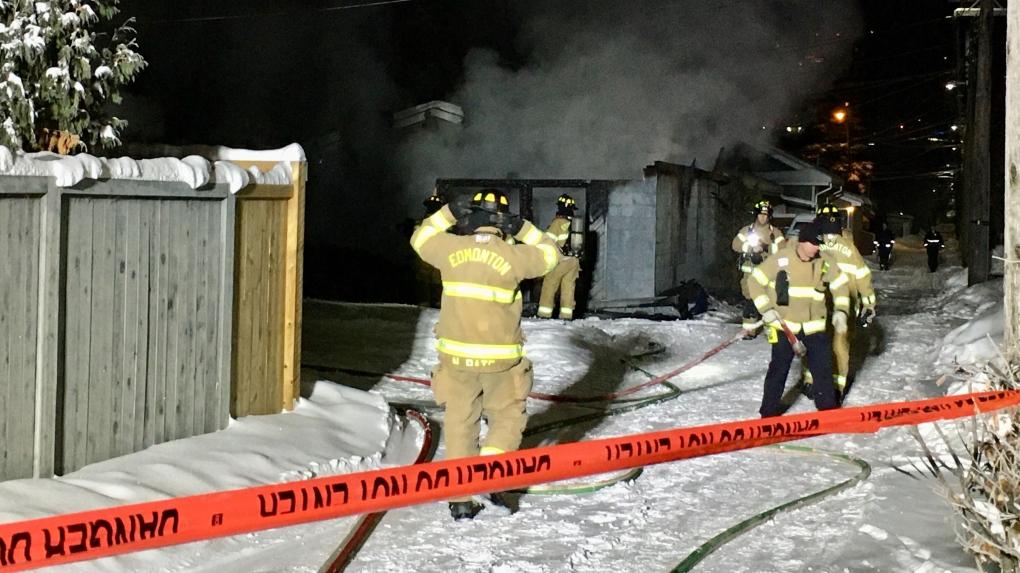 Firefighters battle early morning garage fire