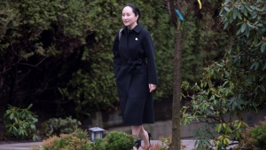 Meng Wanzhou, chief financial officer of Huawei, leaves her home to go to B.C. Supreme Court in Vancouver, Wednesday, January 22, 2020. Wanzhou is in court for hearings over an American request to extradite the executive of the Chinese telecom giant Huawei on fraud charges. THE CANADIAN PRESS/Jonathan Hayward