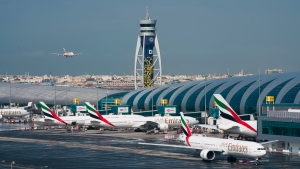 In this Dec. 11, 2019, file photo, an Emirates jetliner comes in for landing at Dubai International Airport in Dubai, United Arab Emirates. (AP Photo/Jon Gambrell, File)