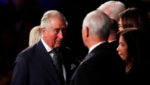 Prince Charles speaks to U.S. Vice President Mike Pence during the World Holocaust Forum marking 75 years since the liberation of the Nazi extermination camp Auschwitz, at Yad Vashem Holocaust memorial centre in Jerusalem, Thursday, Jan. 23, 2020. (Ronen Zvulun, Pool via AP)
