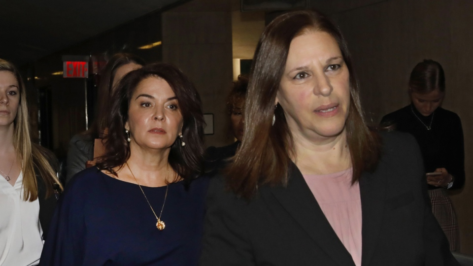 Actress Annabella Sciorra, centre, arrives as a witness in Harvey Weinstein's rape trial in New York, with Assistant District Attorney Joan Illuzzi, right, on Jan. 23, 2020. (Richard Drew / AP)