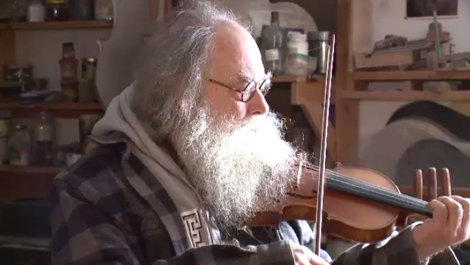 Otis Tomas estimates he has handcrafted at least 500 stringed instruments by hand over the years.