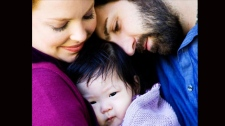 Katherine Heigl and her husband Josh Kelley pose with their adopted 10-month-old baby girl from Korea, Saturday, Sept. 12, 2009. (AP Photo / Cheyenne Ellis, PMK-HBH)