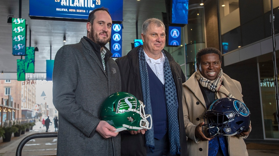 Randy Ambrosie, CFL commissioner, is flanked by Craig Reynolds, left, president and chief executive officer of the Saskatchewan Roughriders, and Mike (Pinball) Clemons, general manager of the Toronto Argonauts, after the league announced a regular season game between the Toronto Argonauts and Saskatchewan Roughriders at a news conference in Halifax on Thursday, Jan. 23, 2020. (THE CANADIAN PRESS/Andrew Vaughan)