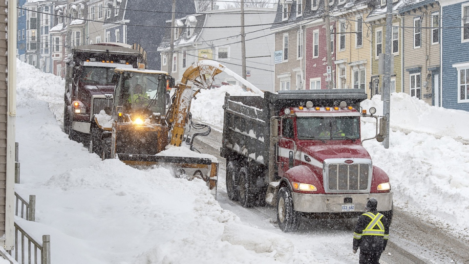 Workers remove snow from the streets in St. John's