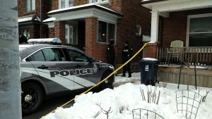 A Toronto police cruiser and investigators are seen outside of a Toronto home on Jan. 23, 2019. (CTV News Toronto / Austin Delaney)