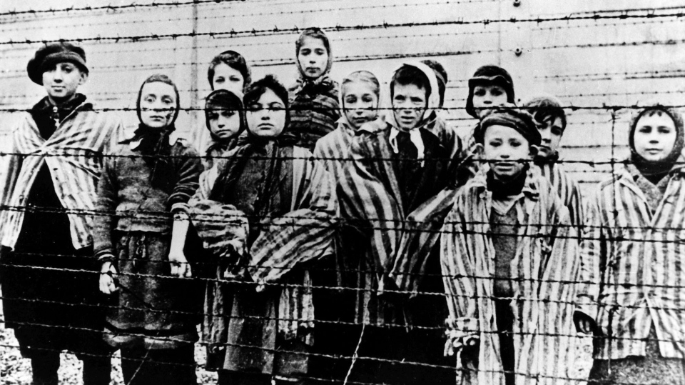 The file picture taken just after the liberation by the Soviet army in January, 1945, shows a group of children wearing concentration camp uniforms including Martha Weiss who was ten years-old, 6th from right, at the time behind barbed wire fencing in the Oswiecim (Auschwitz) Nazi concentration camp. (AP Photo)