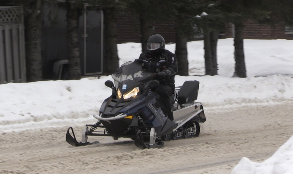 Snowmobile rider on Victoria Avenue, Timmins