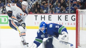 Edmonton Oilers centre Connor McDavid (97) fails to get a shot past Vancouver Canucks goaltender Jacob Markstrom (25) during third period NHL action in Vancouver on Monday, December, 23, 2019. When the NHL returns from its bye weeks and all-star break, there will be just over 30 games left for each team. THE CANADIAN PRESS/Jonathan Hayward