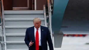 U.S. President Donald Trump arrives to the Miami International Airport on Thursday, Jan. 23, 2020, in Miami. (AP Photo/Brynn Anderson)