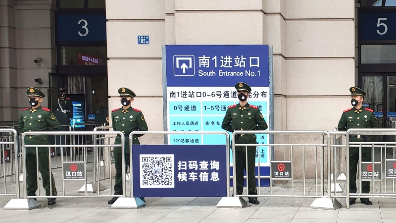 Paramilitary police stand guard at an entrance to the closed Hankou Railway Station in Wuhan in central China's Hubei Province, Thursday, Jan. 23, 2020. China closed off a city of more than 11 million people Thursday in an unprecedented effort to try to contain a deadly new viral illness that has sickened hundreds and spread to other cities and countries in the Lunar New Year travel rush. (Thepaper via AP)