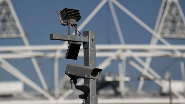 In this file photo dated Wednesday, March 28, 2012, a security CCTV camera is seen by the Olympic Stadium at the Olympic Park in London. (AP Photo/Sang Tan, FILE)