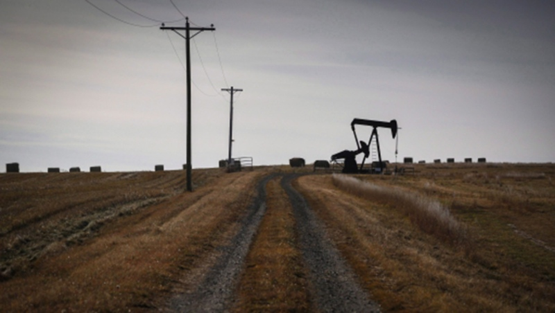 A pumpjack works at a well head on an oil and gas installation near Cremona, Alta., on October 29, 2016. A group of Alberta landowners is asking farmers and ranchers to fight back against unpaid debts and unreclaimed oil and gas wells by closing valves and cutting power to energy company sites. THE CANADIAN PRESS/Jeff McIntosh