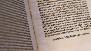A detail of a page of an authentic 15th century copy of a letter written by Christopher Columbus as displayed at the Vatican, Thursday, June 14, 2018. (Tony Gentile/Pool Photo via AP)