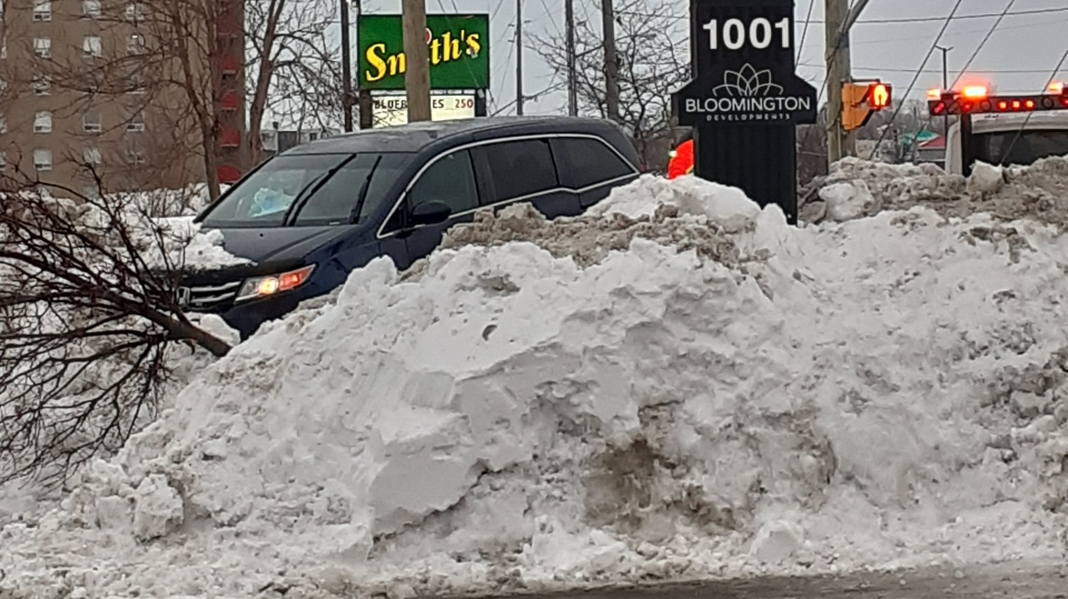 Suspect crashes alleged stolen Honda minivan into snowbank on Lasalle Blvd. Jan. 24, 2020 (Susan Landells)