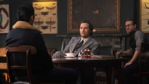"""This image released by STXfilms shows, from left, Henry Golding, Matthew McConaughey and Charlie Hunnam in a scene from """"The Gentlemen."""" (Christopher Raphael/STXfilms via AP)"""