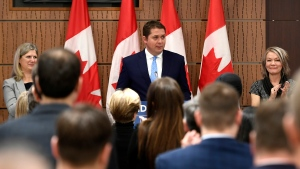 Caucus members give a standing ovation to Conservative Leader Andrew Scheer as he delivers remarks during the Conservative caucus retreat on Parliament Hill in Ottawa, on Friday, Jan. 24, 2020. THE CANADIAN PRESS/Justin Tang