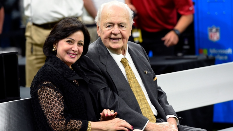 "In this Sept. 17, 2017, file photo, New Orleans Saints owner Tom Benson sits on the sideline with his wife, Gayle Benson, before an NFL football game in New Orleans. Attorneys for several men suing the Roman Catholic church say documents they obtained through discovery show that the New Orleans Saints team aided the Archdiocese of New Orleans in its ""pattern and practice of concealing its crimes."" (AP Photo/Bill Feig, File)"