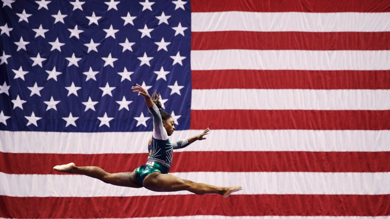 Simone Biles competes on the beam during the senior women's competition at the 2019 U.S. Gymnastics Championships, Aug. 9, 2019, in Kansas City, Mo. (AP Photo/Charlie Riedel)
