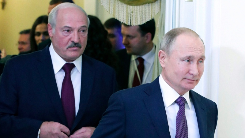In this file photo taken on Friday, Dec. 20, 2019, Russian President Vladimir Putin, right, and Belarusian President Alexander Lukashenko walk before a meeting of the Supreme Eurasian Economic Council in St. Petersburg, Russia. (Mikhail Klimentyev, Sputnik, Kremlin Pool Photo via AP, File)