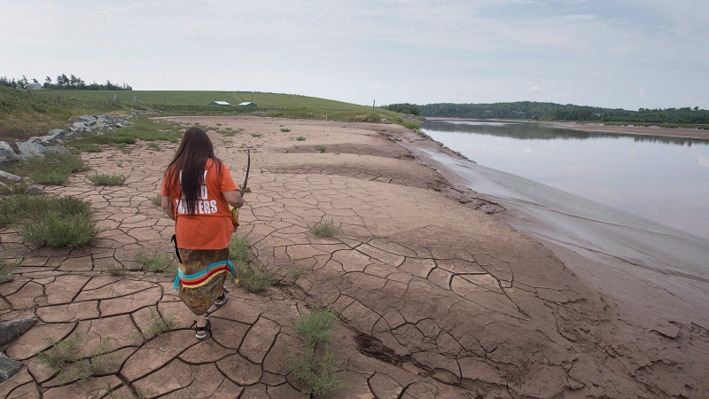 Mi'kmaq activist Dorene Bernard walks on the shores of the Shubenacadie River, a 72-kilometre tidal river that cuts through the middle of Nova Scotia and flows into the Bay of Fundy, in Fort Ellis, N.S. on Tuesday, July 31, 2018. THE CANADIAN PRESS/Andrew Vaughan