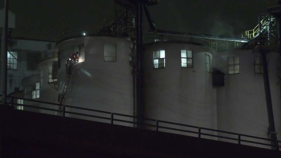 Crews from Vancouver Fire Rescue Service have been battling a stubborn fire in a grain elevator at the Port of Vancouver for more than 24 hours. (CTV)
