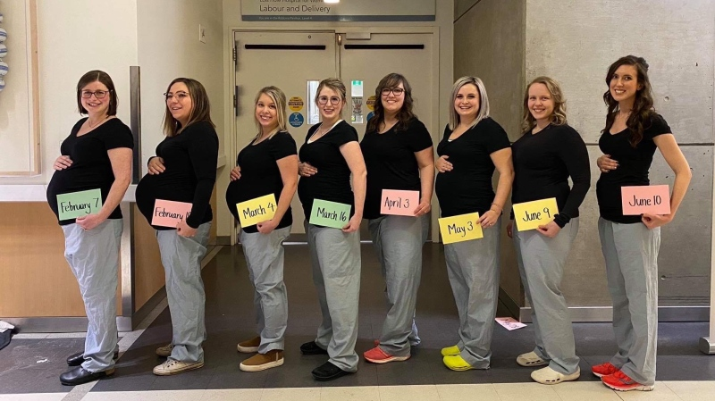 Eight of 14 expecting nurses in the Royal Alexandra Hospital's labour and delivery unit pose for a photo.