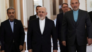 Iran's Foreign Minister Mohammad Javad Zarif, center, arrives prior to a meeting with his Venezuelan counterpart in Tehran, Iran, Monday, Jan. 20, 2020. Iran's top diplomat has cancelled his trip and will not be attending the Davos Forum, the Iranian Foreign Ministry said Monday amid a crisis with Washington and disputes with Europe over Iran's nuclear steps. (AP Photo/Vahid Salemi)