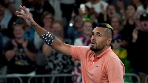 Australia's Nick Kyrgios waves to the crowd as he celebrates after defeating Russia's Karen Khachanov in their third round singles match at the Australian Open tennis championship in Melbourne, Australia, Saturday, Jan. 25, 2020. (AP Photo/Lee Jin-man)