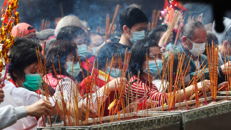 People burn joss sticks as they pray at the Wong Tai Sin Temple, in Hong Kong, Saturday, Jan. 25, 2020 to celebrate the Lunar New Year which marks the Year of the Rat in the Chinese zodiac. (AP Photo/Achmad Ibrahim)