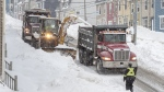 Workers continue to remove snow from the streets in St. John's on Tuesday, January 21, 2020. The state of emergency ordered by the City of St. John's continues for a fifth day, leaving most businesses closed and most vehicles off the roads in the aftermath of the major winter storm that hit the Newfoundland and Labrador capital. The city has allowed grocery and convenience stores to open for limited hours to let residents restock their food supply. THE CANADIAN PRESS/Andrew Vaughan