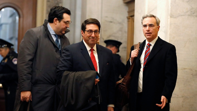 U.S. President Donald Trump's personal attorney Jay Sekulow, center, stands with his son, Jordan Sekulow, left, and White House Counsel Pat Cipollone, while arriving at the Capitol in Washington during the impeachment trial of Trump on charges of abuse of power and obstruction of Congress, Saturday, Jan. 25, 2020. (AP Photo/Julio Cortez)