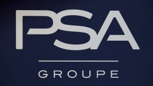 In this Thursday, Feb. 23, 2017, file photo, the logo of PSA Group is pictured in Paris. (AP Photo/Christophe Ena, File)