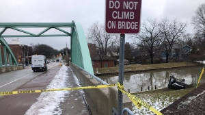 The Windsor Police Service investigates a single-vehicle crash that saw a vehicle end up on the banks of Little River on Jan. 25, 2020. (Alana Hadadean/CTV Windsor)