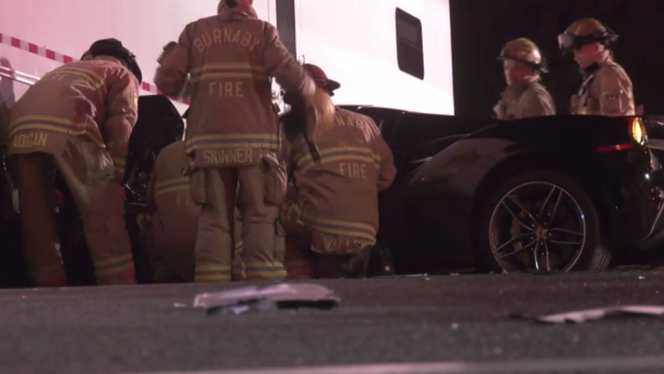 Collision in Burnaby leaves Ferrari wedged underneath semi-trailer truck
