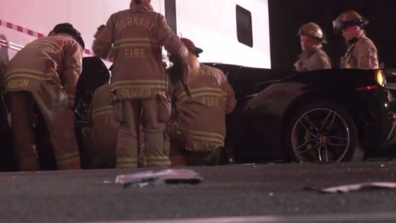 Police, fire and ambulance responded to a collision between a black Ferrari and a semi-truck in Burnaby in the early hours of Saturday, Jan. 25 morning. (CTV)