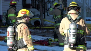 Fire crews work at 19 Tuscany Springs Pl. N.W., where a two-storey home was the scene of a fire on Jan. 25, 2020.