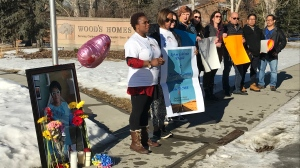 "Supporters of Deborah Onwu held signs and chanted, ""Caregivers, our lives matter too,"" on a Jan. 25, 2020, rally, held exactly three months after Onwu's death."