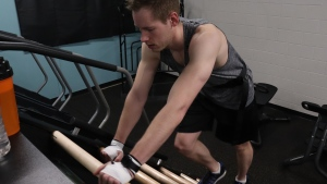 Logan Foth works toward his goal of climbing the height of Mount Everest on a Jacobs Ladder at Fitness Focus in Saskatoon. (Chad Leroux/CTV News)