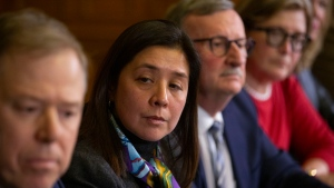 Dr. Eileen de Villa, second left, Medical Officer of Health for the City of Toronto, sits alongside Dr. Andy Smith, left, President and CEO of Sunnybrook Health Sciences, as they attend a news conference in Toronto on Saturday, January 25, 2020, as officials announce that Canada's first presumptive positive case of the Coronavirus is being treated at Toronto's Sunnybrook Health Sciences Centre, after arriving on a flight from China. THE CANADIAN PRESS/Chris Young