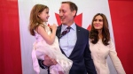 Peter MacKay, centre, holds his daughter Valentia MacKay as his wife Nazanin Afshin-Jam, looks on following MacKay's official campaign launch for leader of the Conservative Party of Canada in Stellarton, N.S. on Saturday, January 25, 2020. THE CANADIAN PRESS/Darren Calabrese