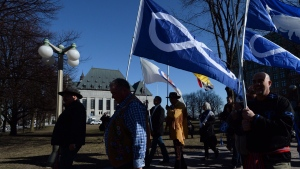 Metis Federation leaders and delagates march to the Supreme Court of Canada in Ottawa, Thursday, April 14, 2016. (THE CANADIAN PRESS / Sean Kilpatrick)