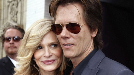 Actress Kyra Sedgwick hugs her husband actor Kevin Bacon, after she was honored with a star on the Hollywood Walk of Fame Monday, June 8, 2009, in Los Angeles. (AP Photo / Damian Dovarganes)